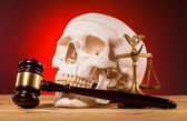 Human scull  scales of justice and gavel — Stock Photo
