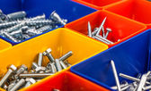 Screws located in a colorful box — Stock Photo