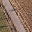 Village road and harvest fields — Stock Photo #64932607