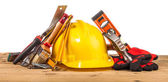 Helmet and wooden mounting tools — Stock Photo