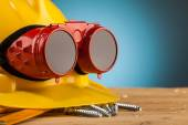 Yellow helmet and wood mounting tools  — Stock Photo