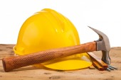 Yellow helmet, hammer and mounting tools — Stock Photo