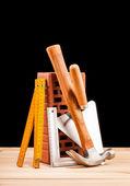 Builder tools on black background — Stok fotoğraf