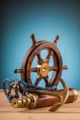 Old anchor wheel and old telescope — Stock Photo