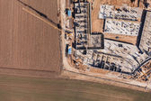 Aerial view of building site and harvest fields — Stock Photo