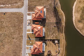 Aerial view over golf field and houses — Stock Photo