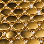 Golden bottle caps — Stock Photo #69093153