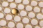 Golden bottle caps — Stock Photo
