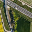 Aerial view of highway and green harvest fields — Stock Photo #72629205