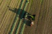 Harvest fields with combine and tractor — Stockfoto