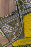 Aerial view of highway and green, yellow harvest fields — Stock Photo