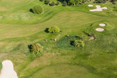 Aerial view over golf field — Stock Photo