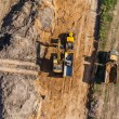 Aerial view of long arm excavator working on the field — Stock Photo #73809025