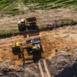 Aerial view of long arm excavator working on the field — Stock Photo #73809069
