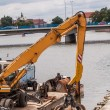 Long arm excavator working on river bank — Stock Photo #75754265