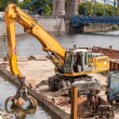Long arm excavator working on river bank — Stock Photo #75754837