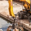 Long arm excavator working on river bank — Stock Photo #75754655