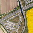 Aerial view of highway and green, yellow harvest fields — Stock Photo #76178659
