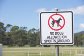Sign Dogs Prohibited on Sports Ground — Stock Photo