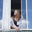 Woman looking out of window waiting — Stock Photo #71554111