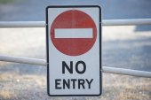 Restricted entry sign at gate of private property — Stock Photo