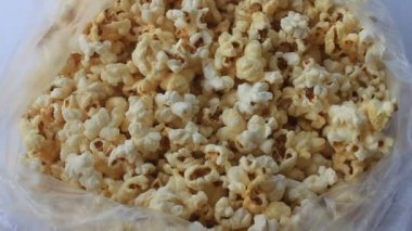 White popcorn containing in plastic bag — Stock Video