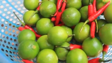 The lemon and chillis in the basket — Stock Video
