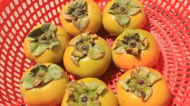 The persimmons in the basket — Stock Video