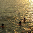 HAI DUONG, VIETNAM, JUNE, 10: people bathing in the river at sun — Stock Photo #54355581