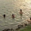 HAI DUONG, VIETNAM, JUNE, 10: people bathing in the river at sun — Stock Photo #54355583