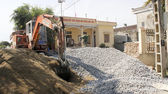 Workers control heavy excavator construction  house  — Stock Photo