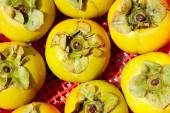 The persimmons in the basket — Stock Photo