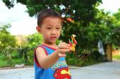 Boy play Tohe, the traditional toys in Vietnam made by colored r — Stock Photo