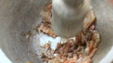 Processing food from shrim and crab by mortar and pestle — Stock Video