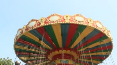 Flying with Merry-go-round over the trees. — Stock Video