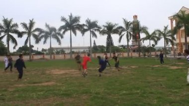 HAI DUONG, VIETNAM - DECEMBER 10, 2014 People Sport Play Football Soccer Kid Children Run Little Boys — Stock Video