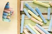 Colorful chalks on table — Stok fotoğraf