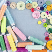 Multicolored buttons and spools of thread1 — Stock Photo