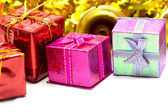 Christmas background with ornament and gift box — Stock Photo