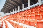 Amphitheater of orange seats — Stock Photo