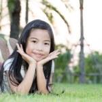 Asian little girl lying in the park — Stock Photo #70647889