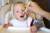 Feeding baby with a spoon — Stock Photo