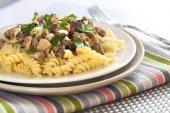 Spiral pasta with morel mushrooms — Stock Photo