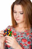 Beautiful woman solves puzzle — Stock Photo