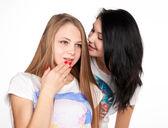 Attractive girlfriends gossiping — Stock Photo