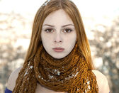 Closeup portrait of beautiful girl in snow-covered scarf — Stock Photo