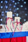 Adorned decor with two candles on the background bokeh — Stock Photo