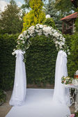 Arch and two white chairs in golf club prepared for weeding. Don — Stock Photo