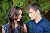 Young beautiful couple in love on nature together  — Stock Photo