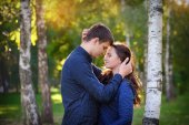 Happy young couple in love outdoor in autumn  — Stock Photo